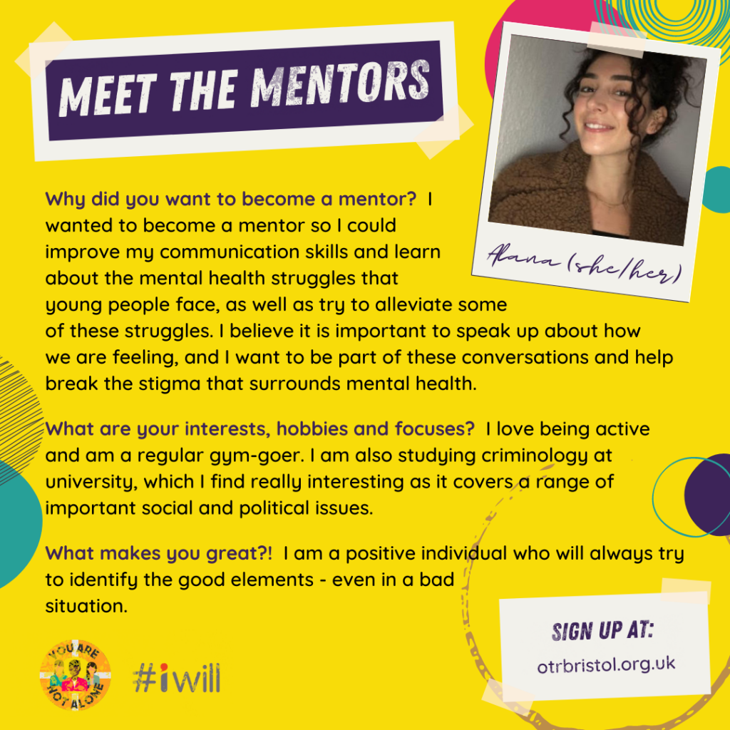 Meet the Mentors: Anna (she/her). Anna has brown curly hair and smiles at camera.