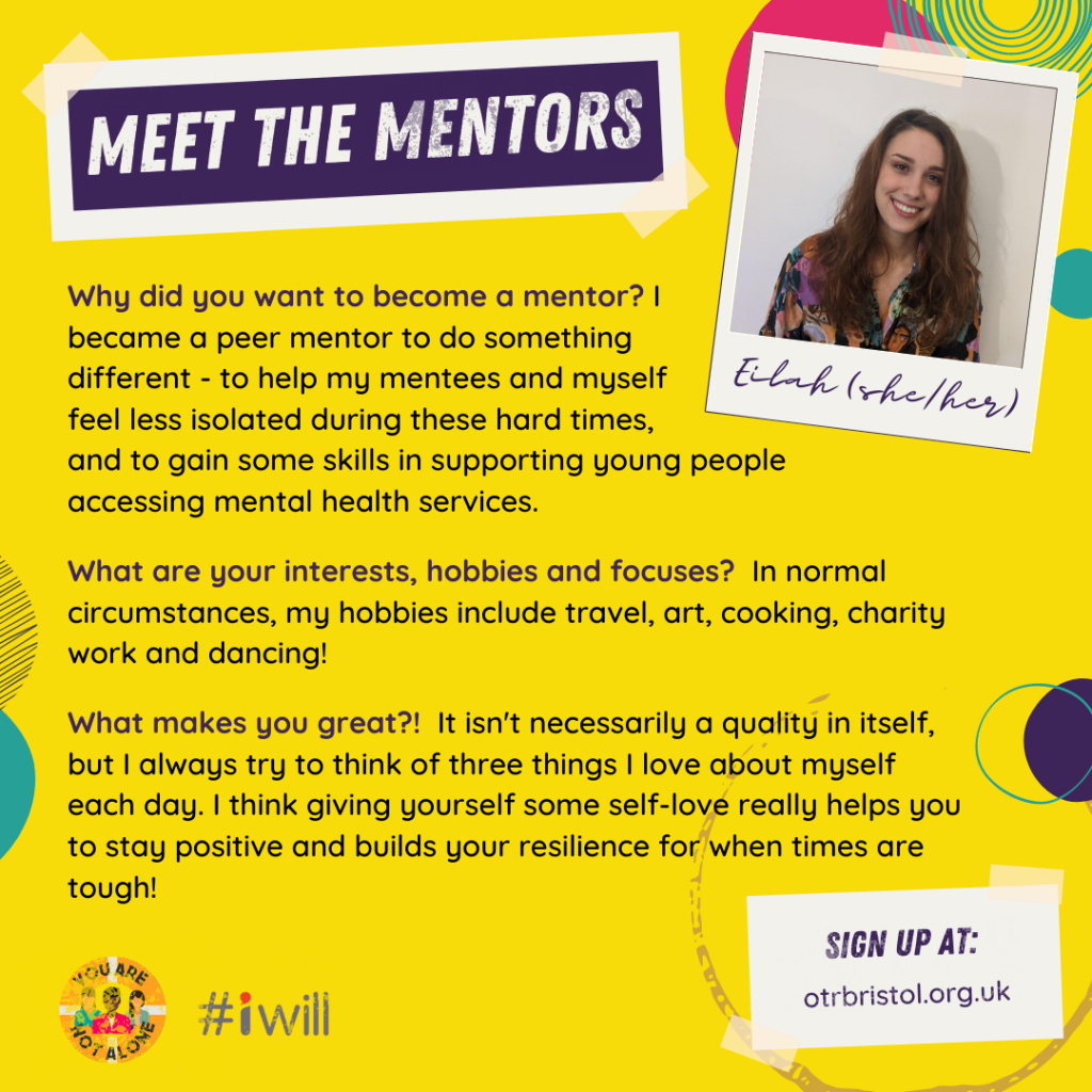 Meet the Mentors: Eilah (she/her). Eilah has long brown hair and a colourful shirt and smiles in front of a white background.